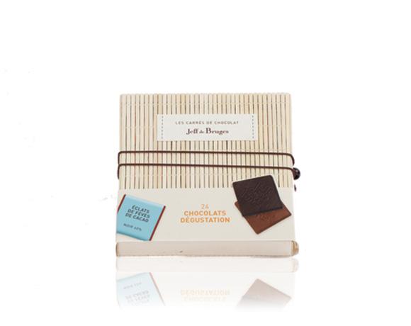 24 malých tabulek čokolády v krásném balení ve formě knihy, z přírodního bambusu.