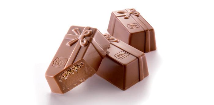 Čokolády mléčné (150 Kč/100 g)