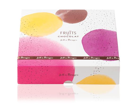 čtvercová barevná krabička obsahuje ještě více lahodného ovoce v čokoládě namíchaného z pěti druhů: meruňka, limetka, švestka, amarena a datle.